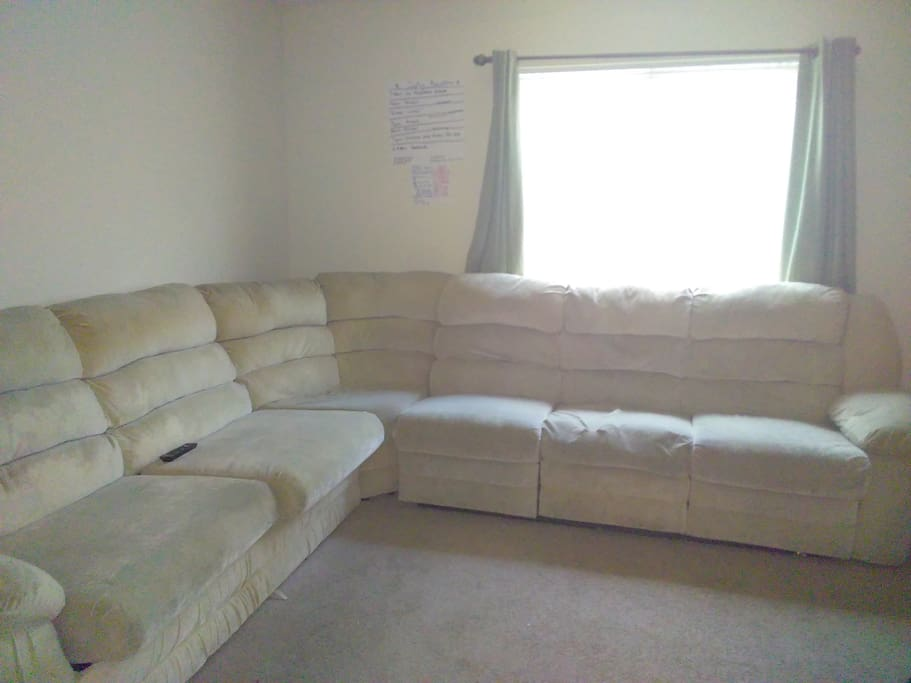Shared living room has pull out bed and two seats recline