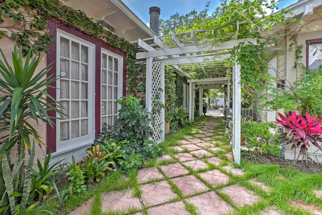 A welcoming garden highlights this 2-bedroom, 1-bath home for 6.