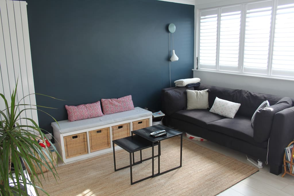 Living room area (part of open living room and dining area) which contains sofa and TV (with access to Sky satellite).