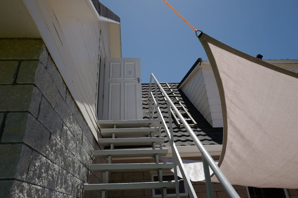 Your room is through the garage and up these stairs.