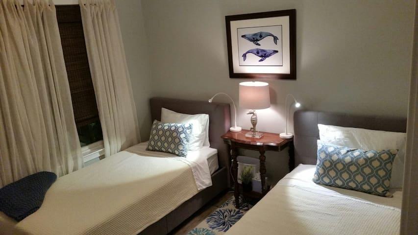 Twin beds in west bedroom.