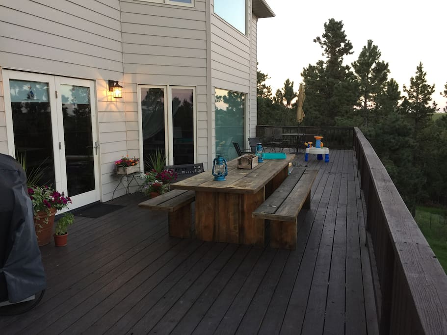 deck with gas grill, extra large wooden table and round table with amazing views