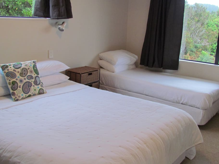 King bed and single in a spacious bedroom - all linen provided