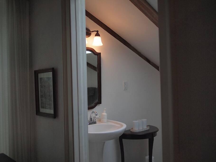 Ensuite bathroom features a deep-well skylight, authentic cast-iron tub,  new porcelain appliances.