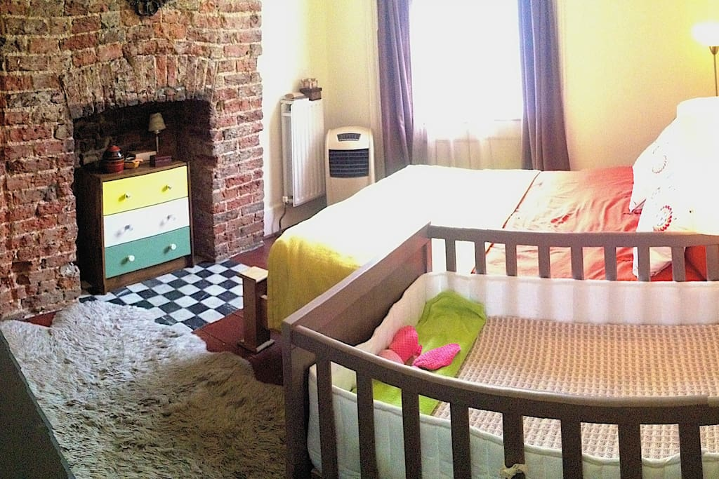 Bedroom has normal full (double) bed + child's crib + changing table