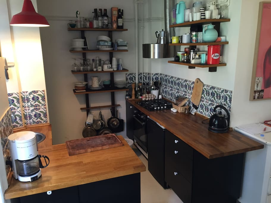 Kitchen with dishwasher, gas stove and electrical oven.
