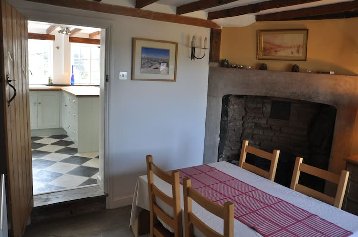 Cosy breakfast room with wood burning stove