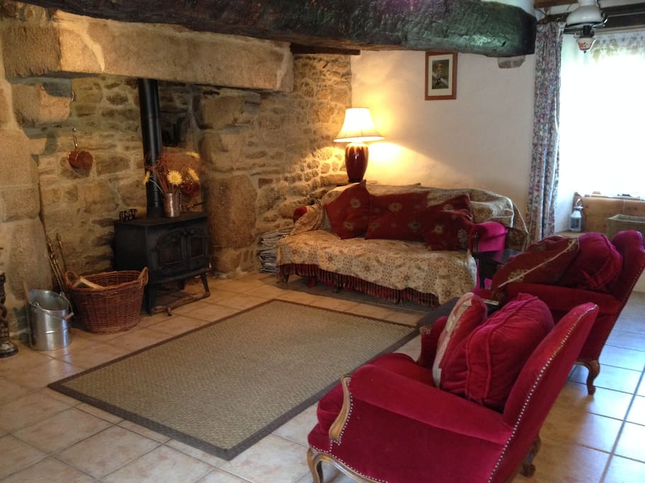 Cosy sitting room with wood burner.