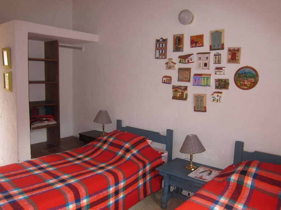 This room has been arranged to have a couple of single beds as a huge super-comfortable double bed!