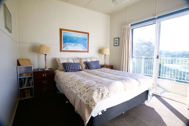 BR2 has a Queen bed with sliding glass door to wrap around deck and ocean views from bed