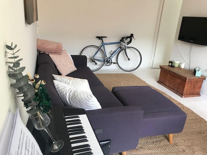 Modern beach-style flat with balcony oasis