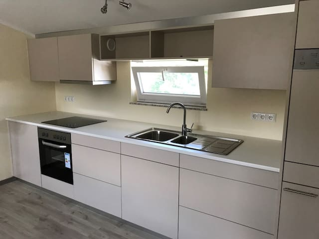 Brand new kitchen incl. oven, dishwasher, fridge, lots of storage space