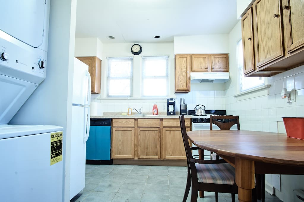 Kitchen with washer/dryer, refrigerator, dishwasher, pots/pans, plates, silverware, glasses, etc.