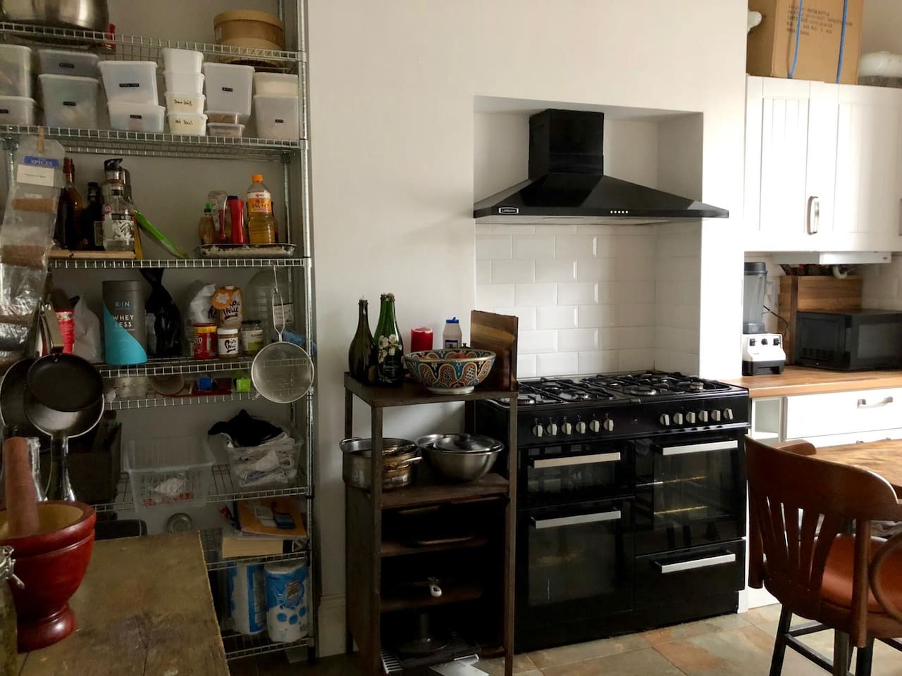 Well stocked communal kitchen with 8 burner stove, Vitamix, 2 ovens...