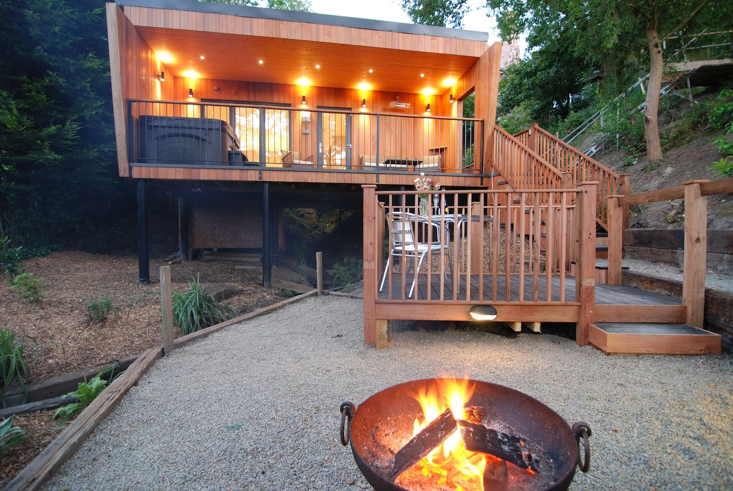 The up/down lights accentuate the red cedar cladding.