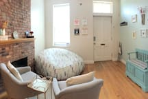 Panoramic photo of first floor facing front door from kitchen