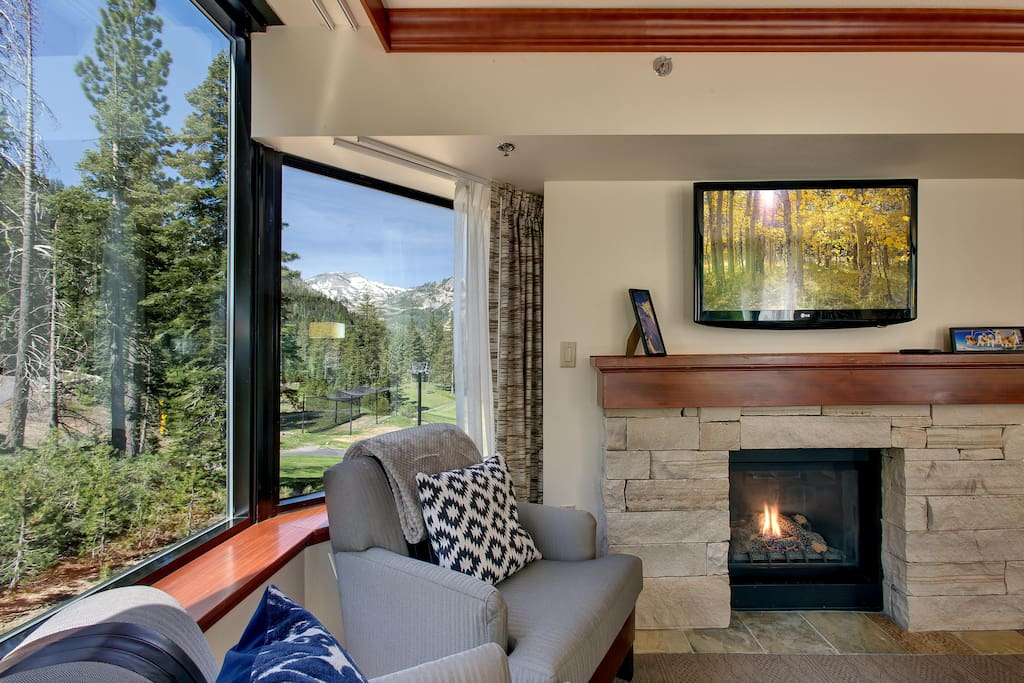 Living room w/ a view. Cozy up to the fireplace.