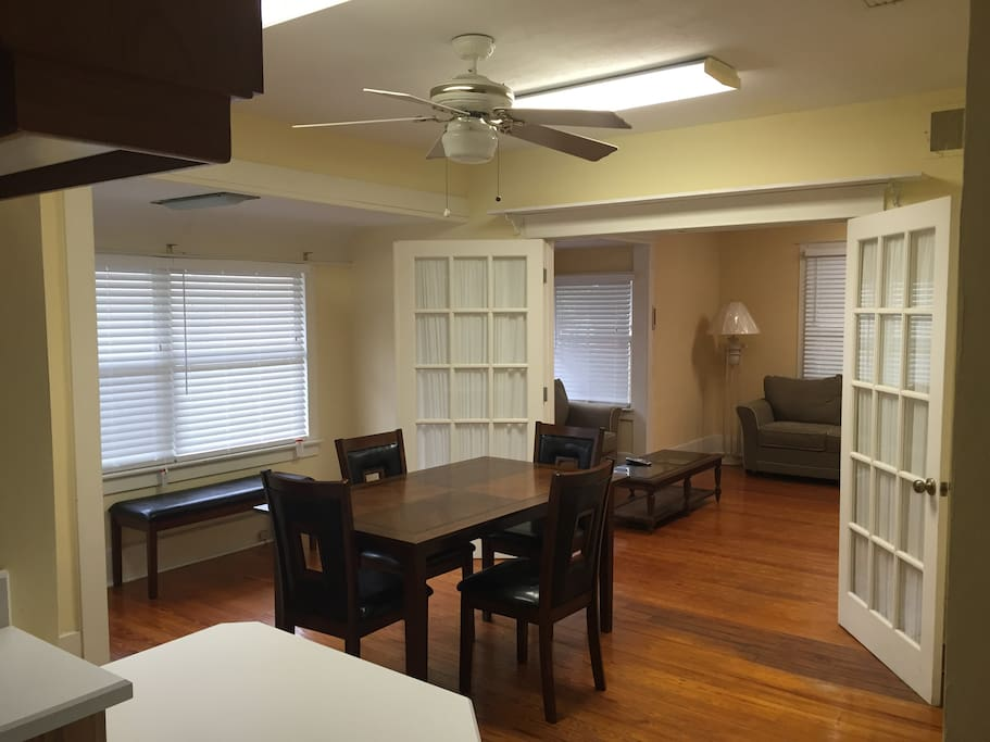 open dining area with bench in window nook