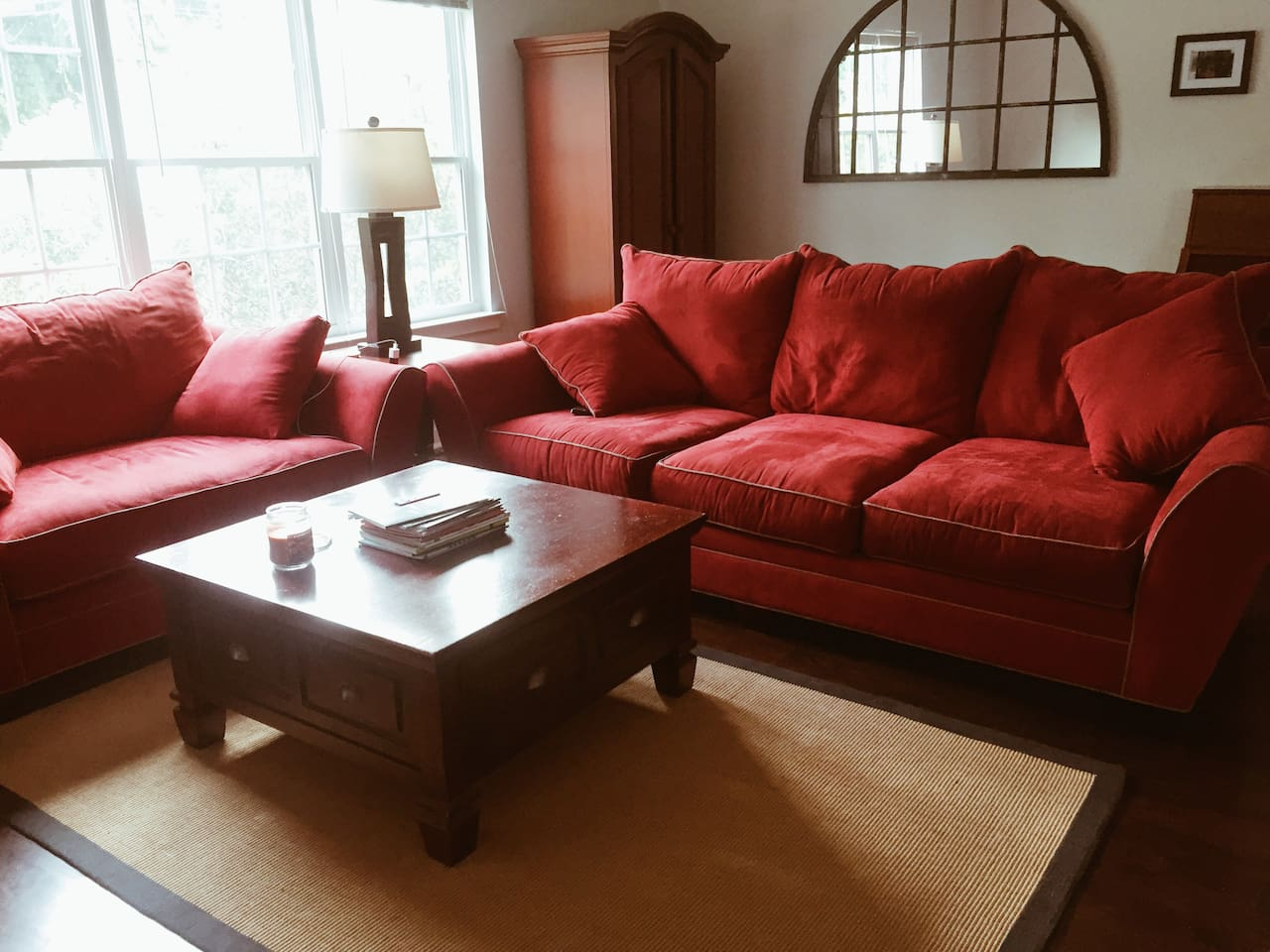 Make yourself comfortable on our big red couches. (They're huge!)