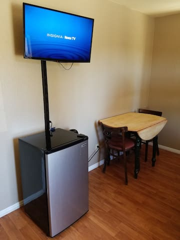 Roku Smart TV, MiniFridge, Table and Chairs