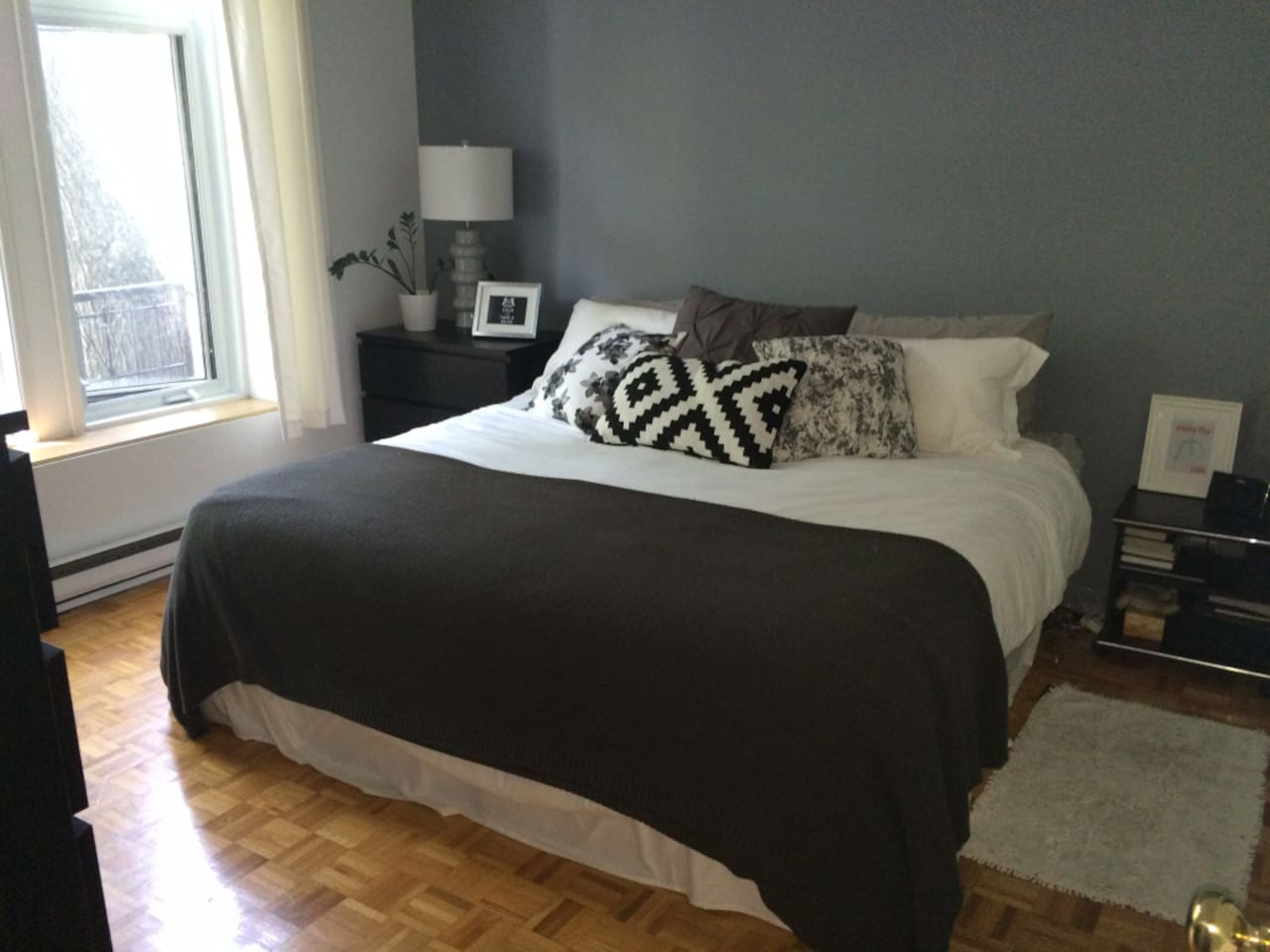 Large bedroom. King size bed with a huge window.