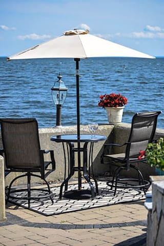Bistro table by the sea wall for drinks, dinner and breakfast by the water!