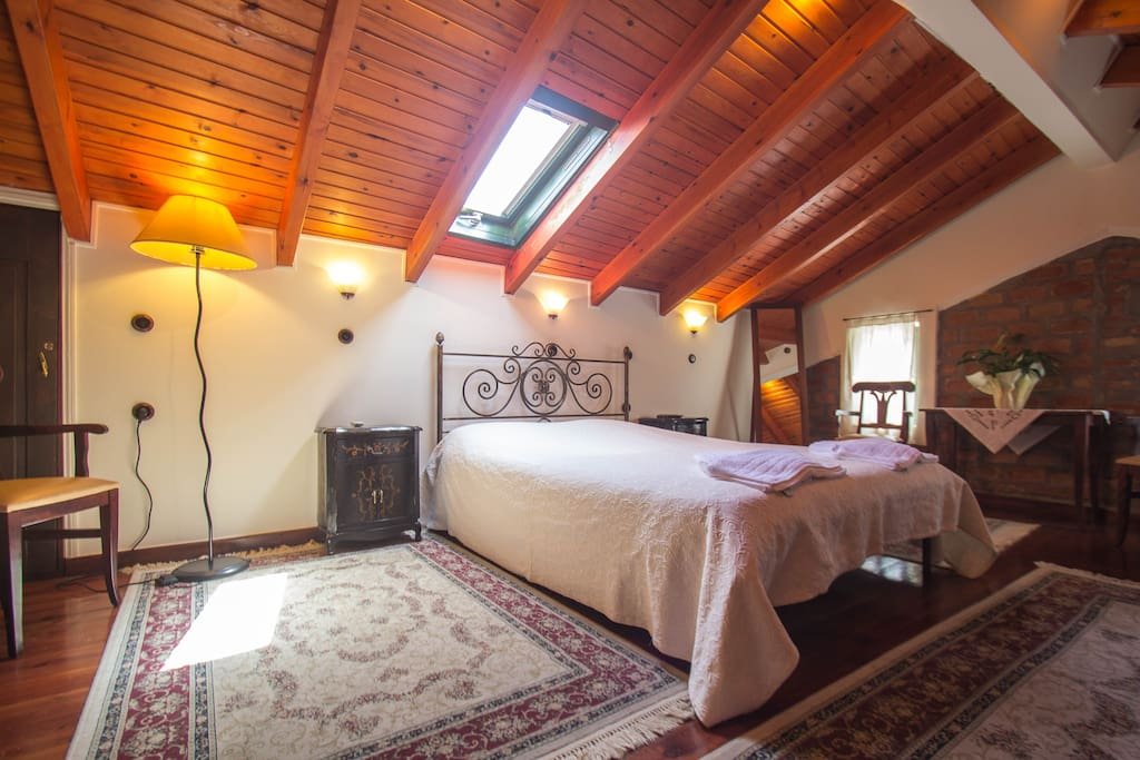 Attic suite bedroom. Master bedroom cosy suite for two people
