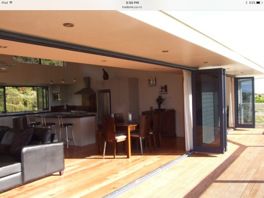 HUGE DOUBLE DOORS ONTO SPACIOUS DECK