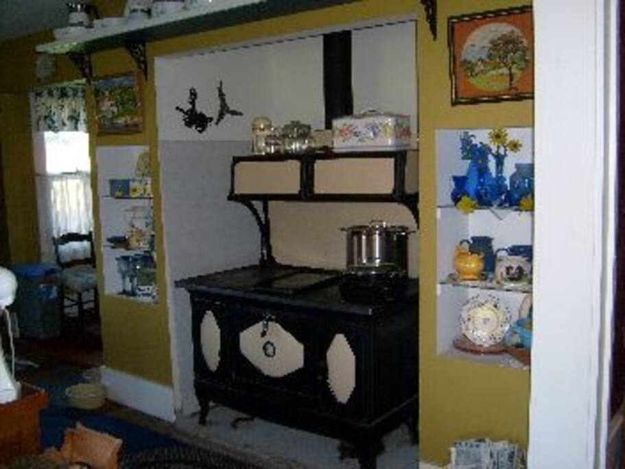 1936 Kalamzoo cast iron wood cook stove warms the kitchen and our hearts.