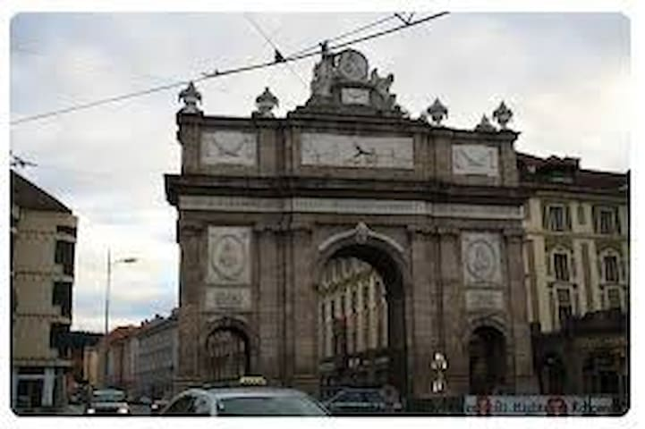 House is just behind the triumphal arc