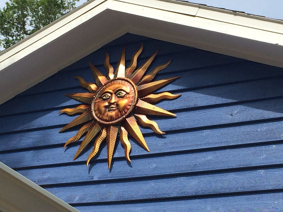 Look for the blue house with the golden sunburst on the roof! That is us!
