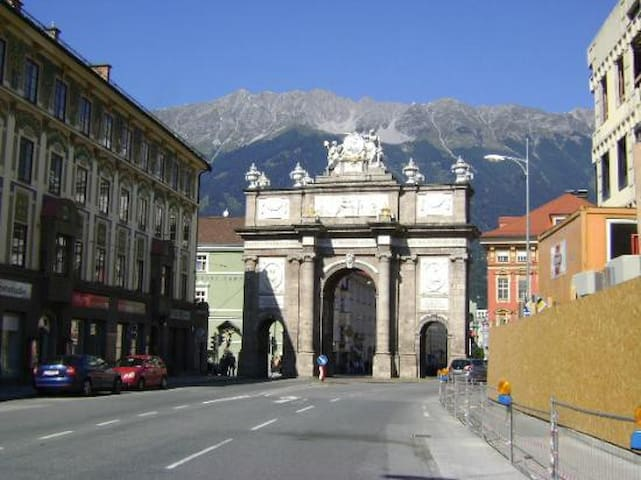 Triumphal arc with the house on the left side