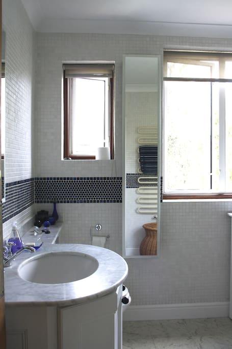 Fully tiled marble bathroom