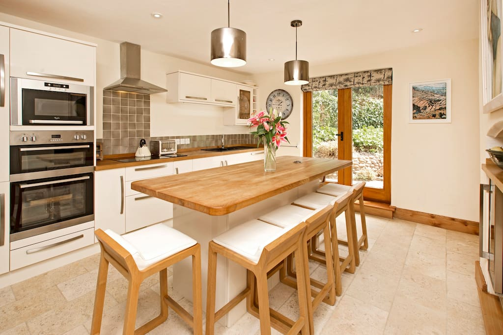 Modern kitchen with island unit seating 6