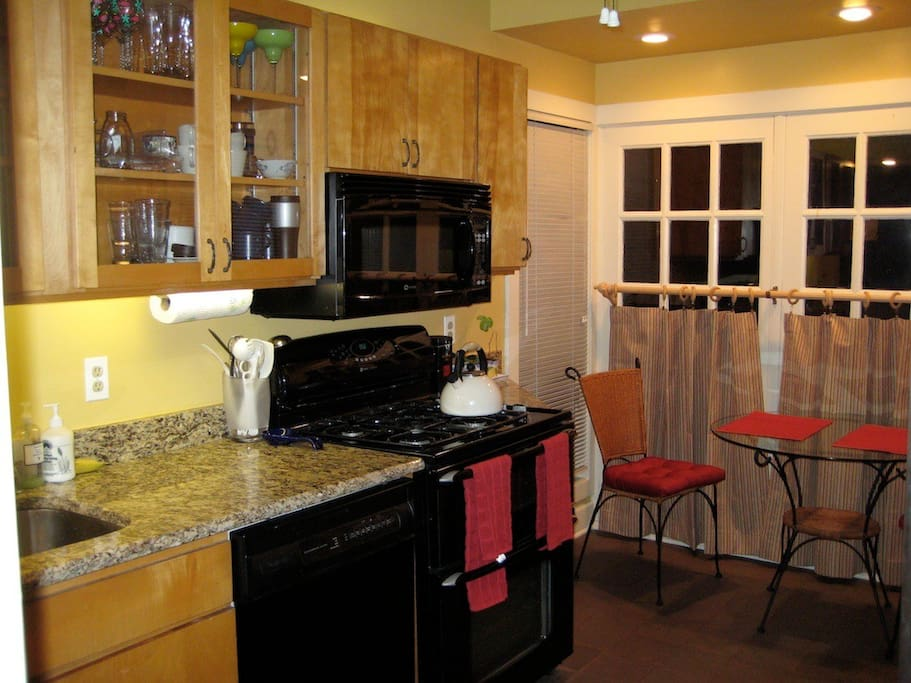 Open kitchen with granite counter tops, dishwasher, and breakfast nook. Guests have full access to kitchen.