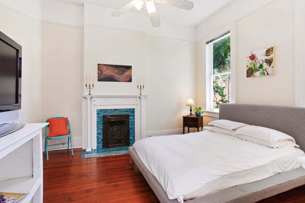 Your bedroom oasis with a massive Live Oak out the front window!