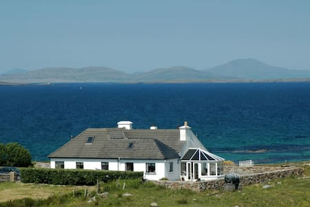 This wonderful award-winning property stands overlooking the magnificent coastline of the Aughrus Peninsula near Cleggan, Connemara, with sandy beaches and a view of magical Inishbofin Island on its doorstep.