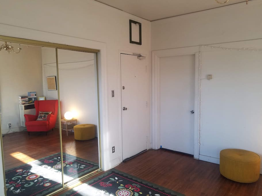 From left: mirrored closet doors, your private entrance, and the door to the living room.
