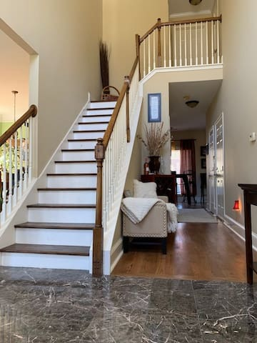 Staircase access from two-story foyer