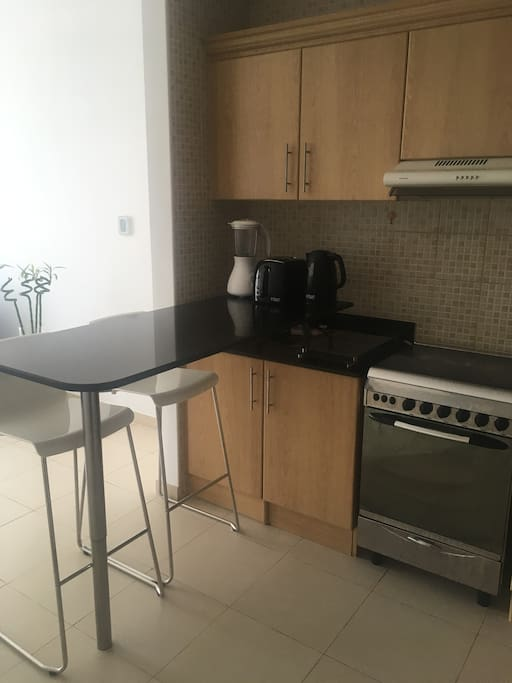 Kitchen with full amenities available.