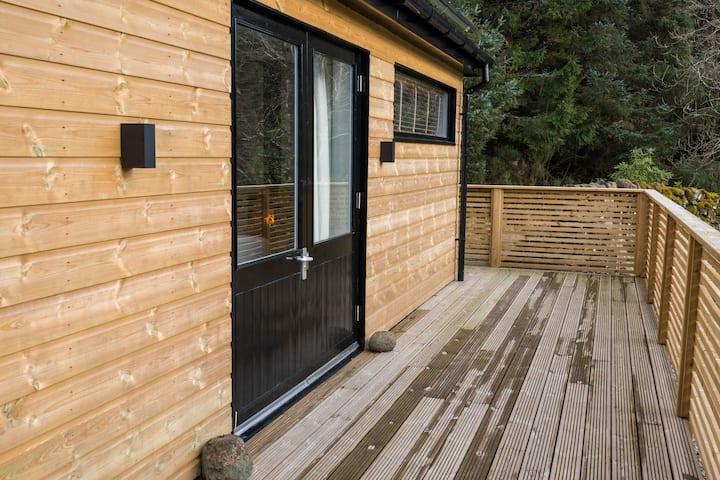 Two bedroom, single-storey detached lodge.