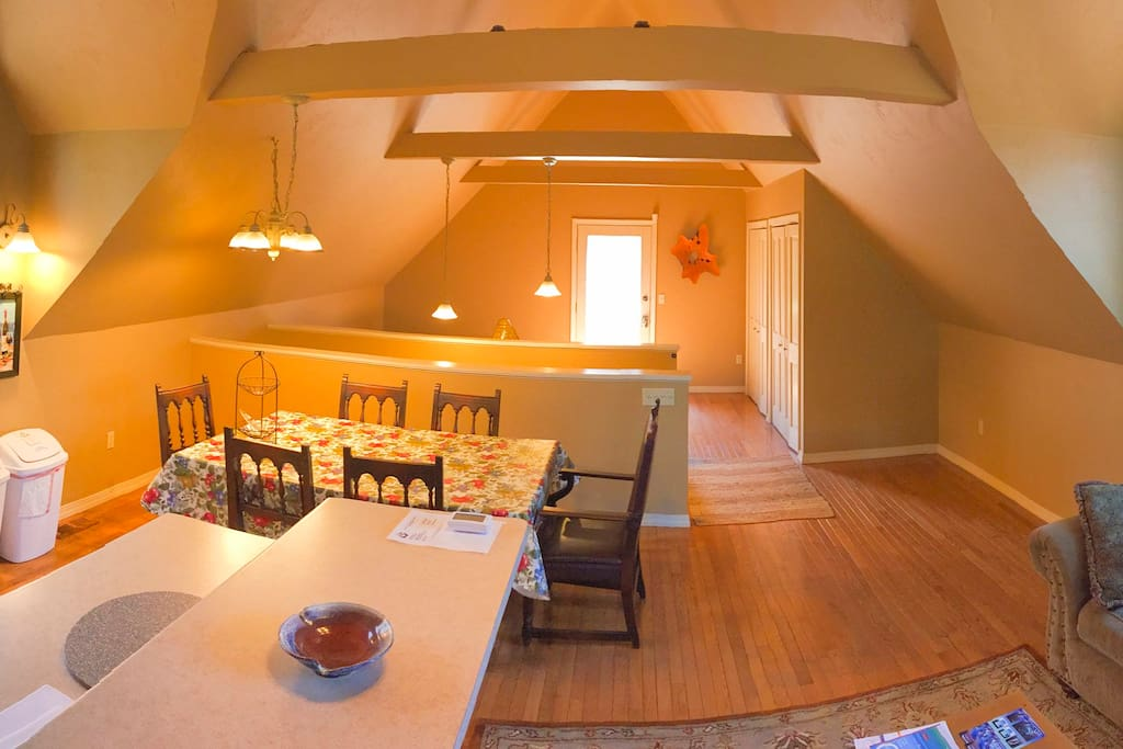 Open Concept Kitchen and Dining Room w/ Lofted Ceilings