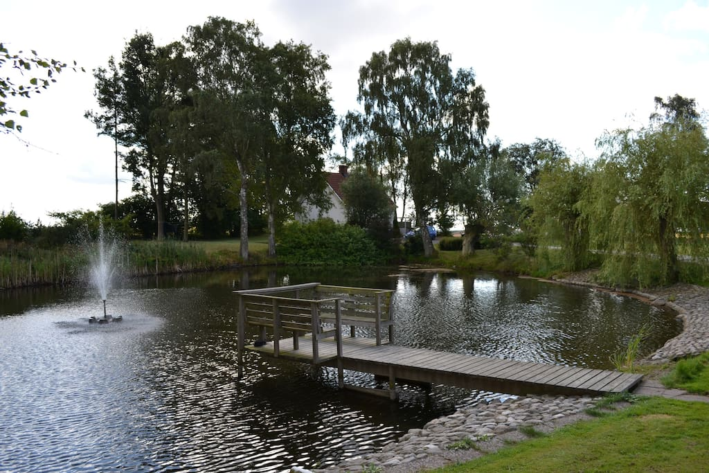 the cottage is surrounded by beautiful parkland with a large pond