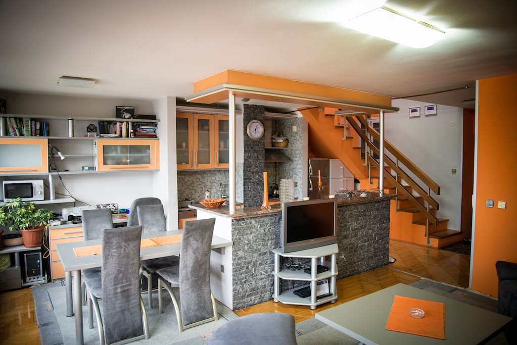 Dining room, kitchen, stairs to the top floor