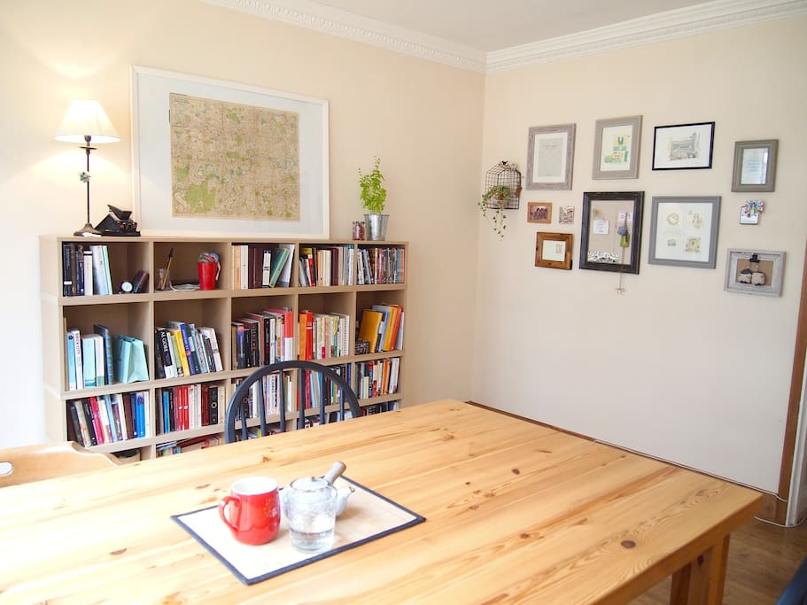 Come have a cup of tea at this big wooden table!