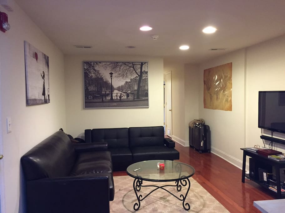 Living room with a couch and futon and apple TV