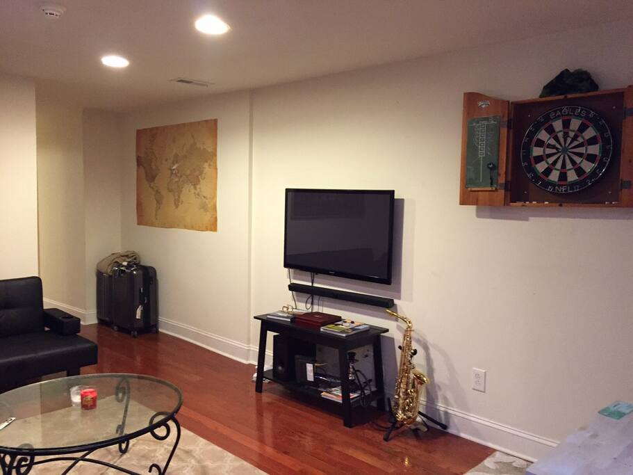 Living Room with dart board (sax not included :)