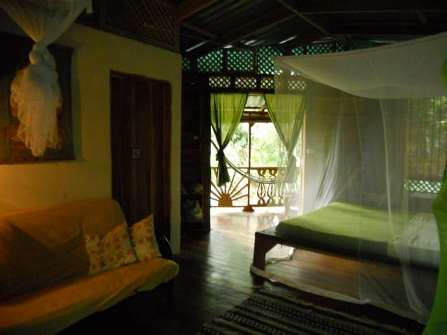 Main top Bedroom with king bed and a single bed with mosquito net