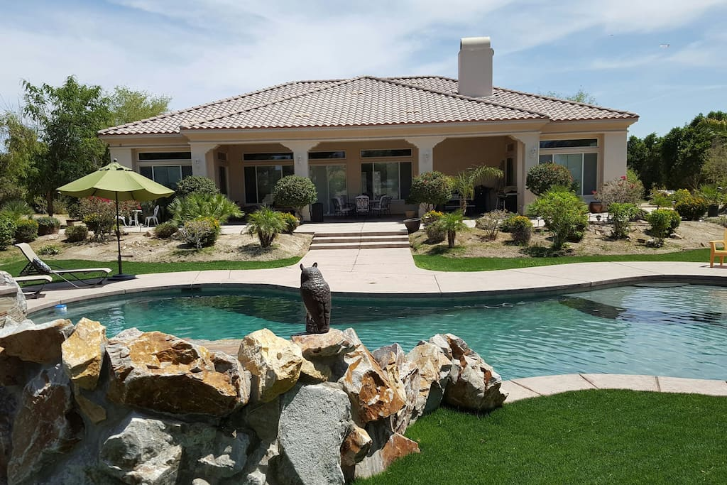 Backside of home with large covered patio.