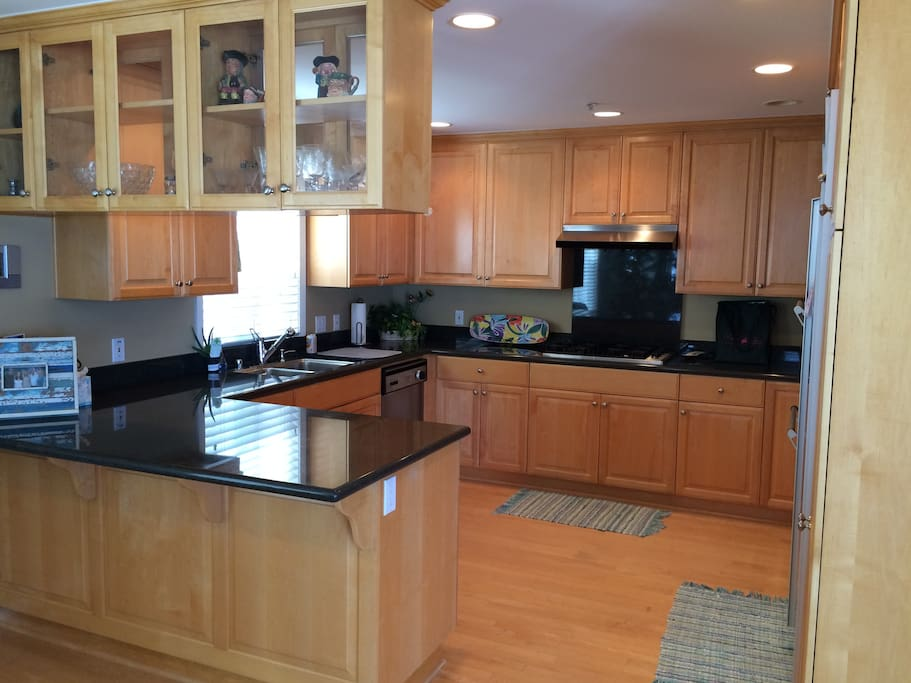 Fully equipped gourmet kitchen with Kuerig coffee/tea maker, toaster oven, and Soda Stream.